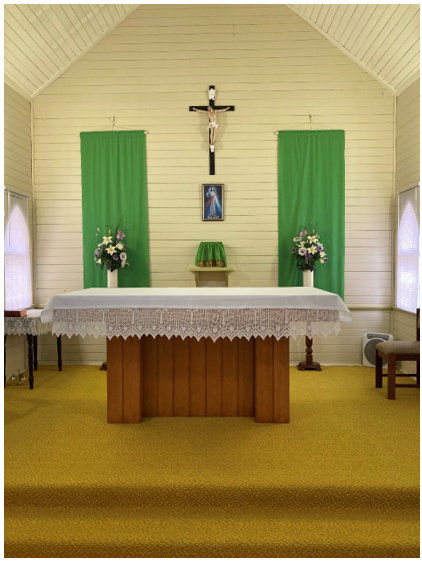 Former St Peter's Catholic Church Crucifix behind the altar at St John's